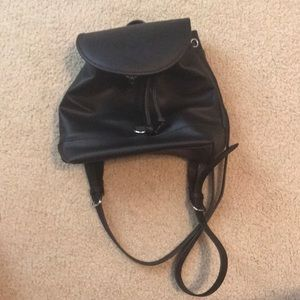 Black purse backpack